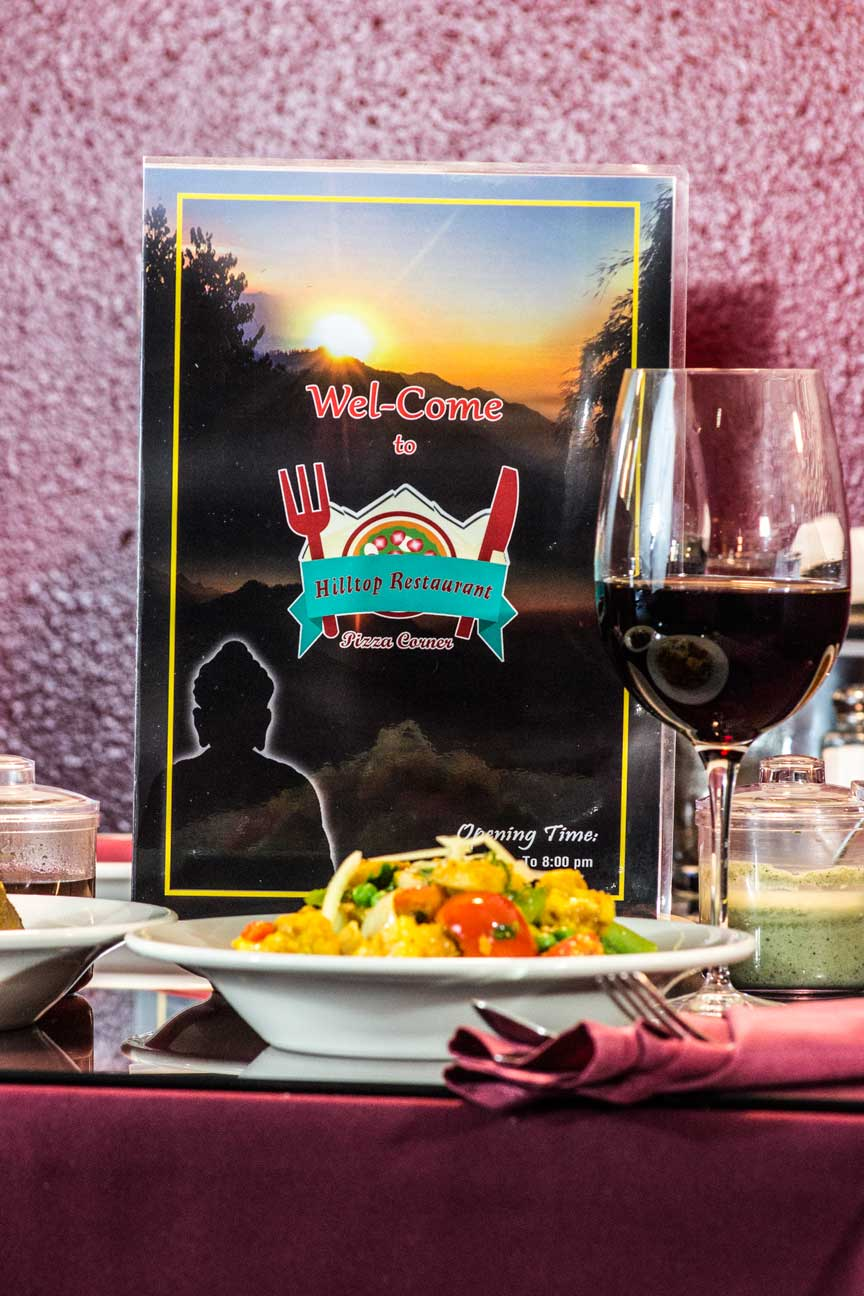 Indian Restaurant menu, food and wine glass in city of Tacoma.