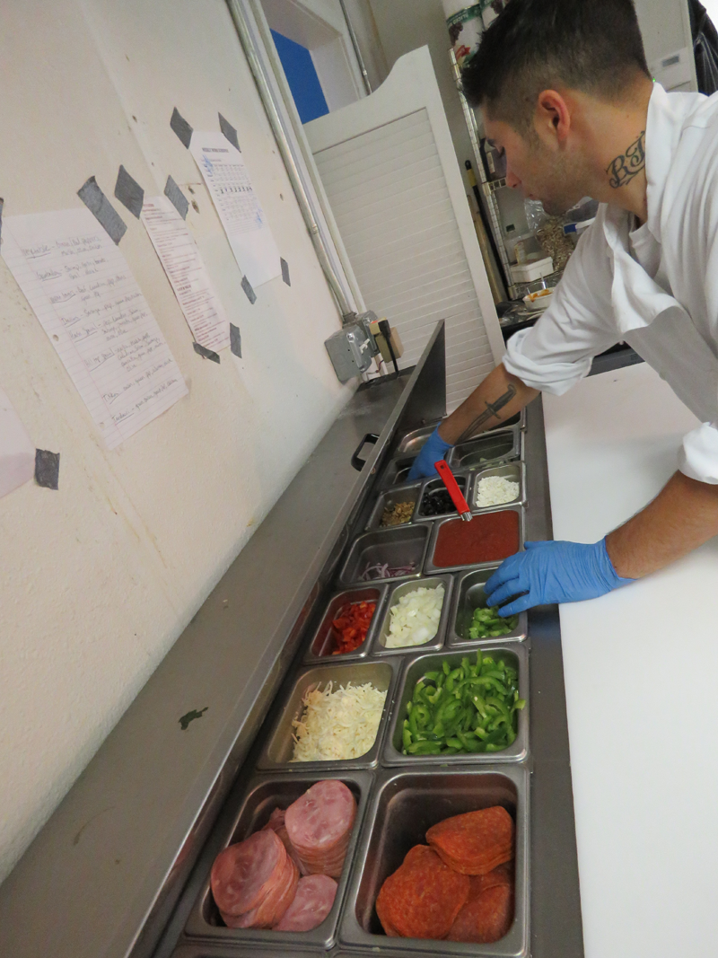 preping fresh ingredients at Hilltop Indian Restaurant.